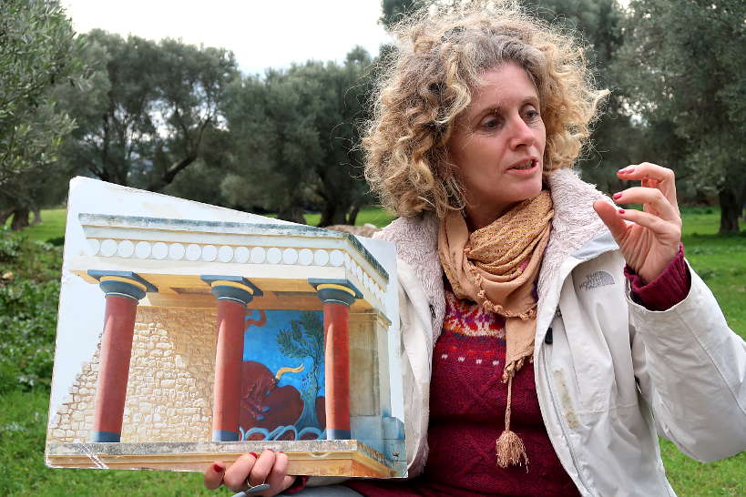 Aspassia showing us knossos imagery for olive oil tasting crete by Authentic Food Quest