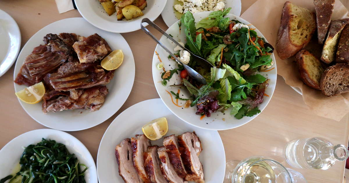 Table spread at Chania Restaurant in Crete by AuthenticFoodQuest
