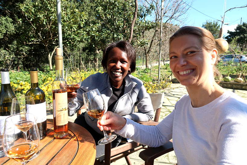 Rosemary and Claire tasting sweet romeiko at Dourakis winery by Authentic Food Quest