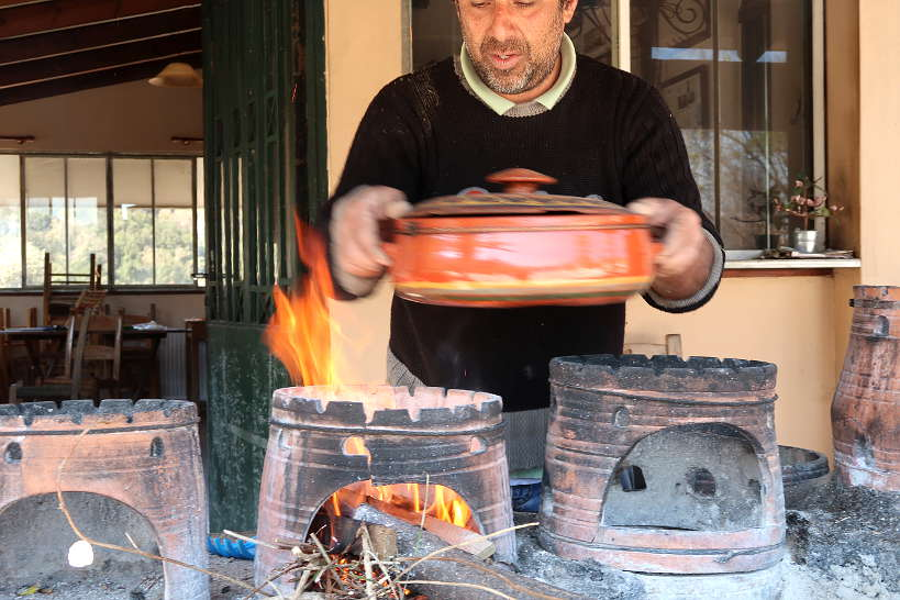 Stelios cooking in clay pot at Dounias restaurant in Chania province Crete by AuthenticFoodQuest