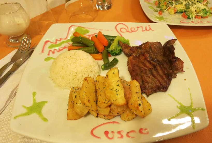 Alpaca steak in Peru by AuthenticFoodQuest