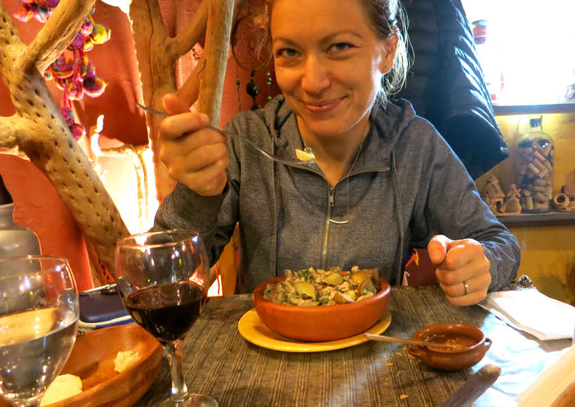 Claire Eating Cazuela de Llama by AuthenticFoodQuest