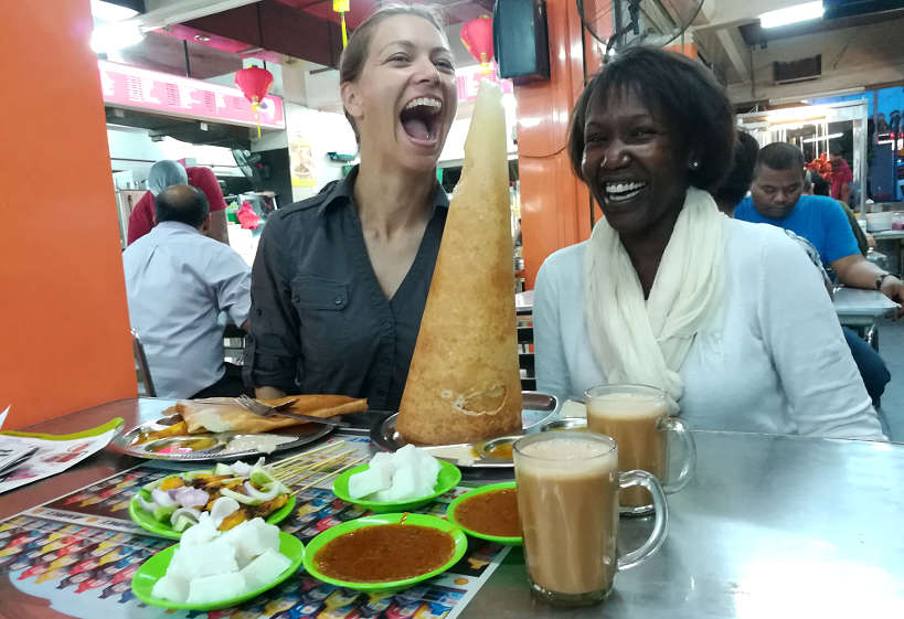 Claire and Rosemary Eating Roti Tisu with Teh Tarik by Authentic Food Quest