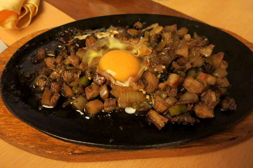 Pork Sisig Served with an Egg by Authentic Food Quest