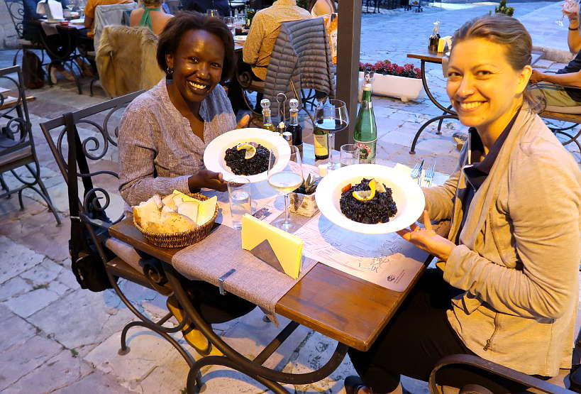 Rosemary and Claire eating black risotto by Authentic Food Quest